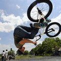 "Justin Jester of Centerton performs a ""flair"" while warming up Saturday before the advanced BMX com..."