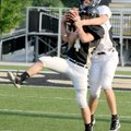 Dakota Baggett, front, intercepts a pass intended for Austin Molitor in Friday's scrimmage in Tiger ...