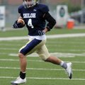 Shiloh Christian's Garrett Harper carries the ball upfield during Tuesday's practice in Champions St...
