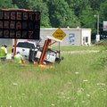 Employees of Direct Traffic Control Inc. of Muskogee, Okla., place a sign on Arkansas 23 just north ...