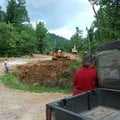 Nancy Seal (foreground) talks to neighbors John and Johnie Bart about work being done on Blackjack L...