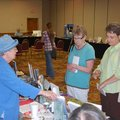 Gravette author Radine Trees Nehring visits with Sandy Kernej of Bentonville and Sandy Pianalto of R...