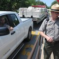 Michael Hurley, right, chief park ranger for Beaver Lake, helps Evan Thiele of Bella Vista purchase ...