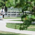 Yolanda Ruiz pushes her son, Daniel Ruiz, 3, around the walking trail at Veterans Park in Rogers on ...