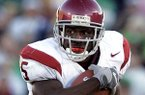 Former Southern California running back Reggie Bush, who won the 2005 Heisman Trophy, was declared ineligible dating back to the Trojans' 2004 national championship season after the NCAA leveled Southern California with stinging penalties Thursday, issuing a two-year bowl ban.