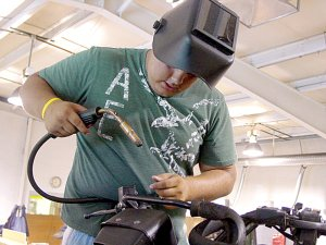 Zack Schooley, Pea Ridge High School agriculture student, welds the handle on a 4-wheeler during Open Shop held recently at the Pea Ridge High School shop facility. The next date for Open Shop is Friday, July 2. Open shop welding