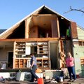 Cindy Wood, far right, stands in front of her tornado-damaged home in Wadena, Minn., on Thursday Jun...