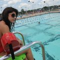 Calli Toler, a lifeguard at the Melvin Ford Aquatic Center in Bentonville, watches swimmers Thursday...