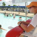 Hillary McBride, a lifeguard at the Melvin Ford Aquatic Center in Bentonville, watches swimmers Thur...