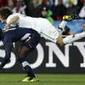 Slovenia's Marko Suler, top, competes for the ball with United States' Jozy Altidore, bottom, during...