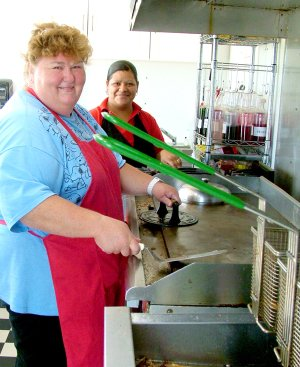 Brenda Ramsey and Alma Gurrerro in the kitchen trailer at the grill of Brenda's Kitchen, a new restaurant on the northwest corner of Slack and Weston streets.