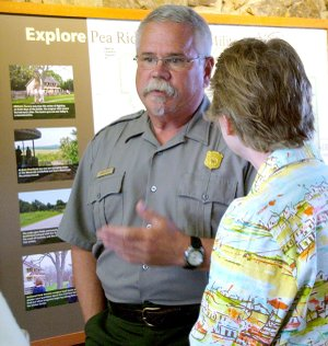 Park superintendent John Scott talks with Colonel Rebecca Jones as the unit from the U.S. Army Sustainment Command arrived at Pea Ridge National Military Park Wednesday.