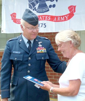 Steve Gray, military and veterans advisor to Congressman John Boozman, presented two medals to Beverly Hillyer, widow of Jackie Hillyer, who served in the U.S. Army in the mid-1950s. Family gathered Monday evening to celebrate.