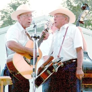 Brothers John and Keith Escue crooned to the crowd as Shady Grove Bluegrass band provided the music Saturday night at the annual Pea Ridge Community Fair. Musicians included Adam Ash, Clyde Gosvener, Brad Fortner, H.K. Scott, John Escue and Keith Escue.