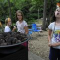 Mary-Grace Ratcliffe, 9, right, blows out her marshmallow while roasting the treats with Haley Richa...