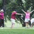 Eva White, middle right, celebrates a difficult par putt with Tammy Dellinger, from left, Jodi Staff...
