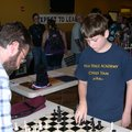 Alex Wolf, 14, right, challenges his dad, Patrick Wolf, a University of Arkansas professor in educat...