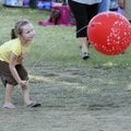 FAIR PLAY - Elisa Johnson, 5, tries to pull her balloon out of the air Friday in the craft area of t...