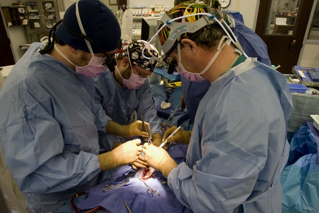 dr-robert-jaquiss-right-performs-heart-transplant-surgery-on-christopher-schroeder-at-arkansas-childrens-hospital-with-registered-nurse-richard-frizzell-center-and-physician-assistant-ed-horgan