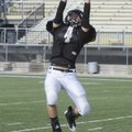 Bentonville defensive back Dakota Baggett intercepts a pass Monday during practice in Tiger Stadium ...