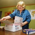 Susan Baldwin packs a box for a family friend stationed overseas on Tuesday, Aug. 10, 2010 in Fairvi...