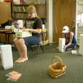 First-grade teacher Stephanie Johnson, left, sorts through lesson material as she works Monday to ge...
