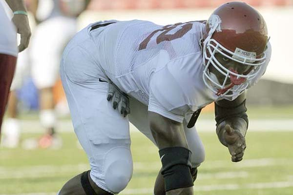 "Chris Smith is among the Razorbacks freshmen who are adjusting to Division I football workouts as well as life away from home. Smith, a defensive end who is expected to contribute this season, said, ""My mom makes some great pork chops. I'm missing that."""