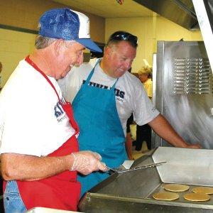 Pancake flippers Bob Kelley and Ken Foxx prepare for the Kiwanis breakfast on Saturday.