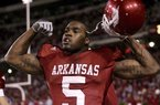 Former Arkansas running back Darren McFadden, a two-time Heisman Trophy runner-up and Doak Walker Award winner, finished his college career with 4,590 rushing yards.