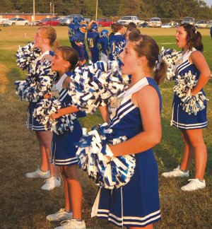 Decatur's cheer leading team made their debut at Monday's junior high game against Gentry. Pictured from left are Lindsey Busby, Celine Prelle, Haley Burden and Lanna Fowler.