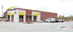 Workers finish up trim work on the exterior of the new McDonald's Restaurant set to open in Gentry next week.