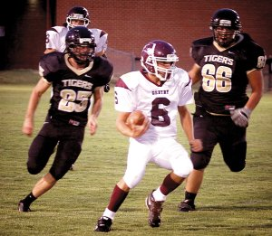 Austin Millsap looks for room to run during last week's scrimmage game against West Fork.