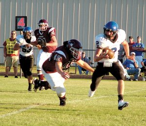 Gentry senior Eathen Ramsey makes Colcord quarterback Canaan Sherrell scramble during the Friday night portion of the game between the Gentry Pioneers and the Colcord (Okla.) Hornets.