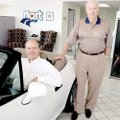 Bob Thornton (standing), owner of Hart BMW and Bill Schwyhart, president of Hart BMW.