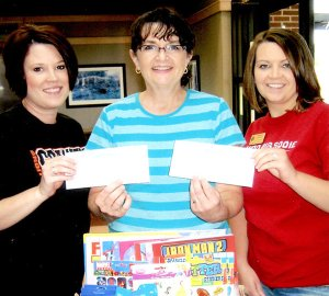 "Misty Austin, left, and Mandy Carnahan, right, from the Bank of Gravett, present the check for St. Jude's Children's Hospital to Dianne Peterson of Hiwasse Country Store, founder of ""Partners of Hope."""