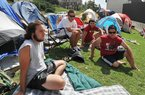 University of Arkansas students (from left) J.P. Turchi, Jacob Parker, Chris Wendel and Juan Oseguera hang out in front of their tents Friday as they talk about Saturday's game between the Razorbacks and No. 1-ranked Alabama.