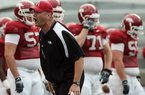 Arkansas strength and conditioning coach Jason Veltkamp (above), shown during practice last month, was part of a freshman class of 30 players and among only five or six to finish as seniors while playing for Bob Petrino, Sr. at Carroll College in Montana.