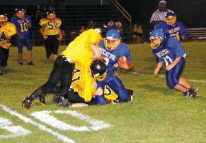 Decatur's junior high player Alan Casteneda is stopped on a run against Hackett on Thursday.