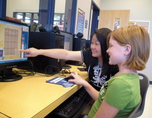 School counselor Maolina Yang helped sixth grade student Hailey Busby use the new Kuder Galaxy program on Monday morning.