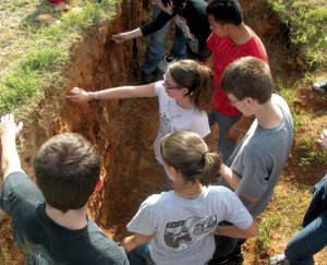 Decatur students Nicole Buckmaster, Josh Hare, Lensey Watson and Sean Wilson identified soil horizons during one of the handson sessions on Wednesday at the University of Arkansas Agricultural Research Station in Fayetteville.