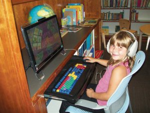 Katrina Nelson, 7, tried out the Gentry Library's new Bilingual Early Literacy Station.