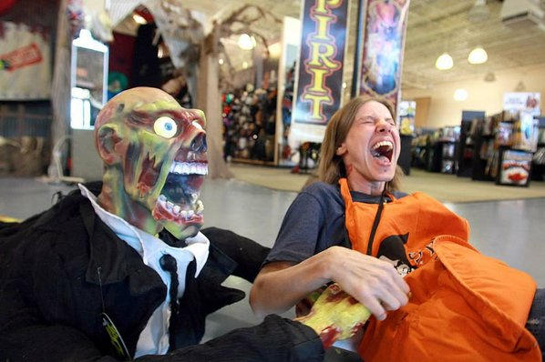 rick mcfarland employee kris crossman right reacts after a robotic zombie grabbed her badge lanyard and pulled her back at spirit halloween in north
