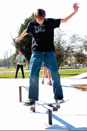 Garrett Blaine tries out a grind bar at the new skate spot skate park in Gentry last Wednesday. As soon as the barricades came down, the skateboarders were there testing their skills in the new facility.