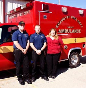 ravette Emergency Medical Technicians stand in front of one of the Gravette ambulances which serve a large area of Northwest Benton County. From the left, Lt. Glenn Boughman, Spencer Gillming and Star Butler, EMS coordinator.
