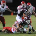 Gentry junior running back Tanner Coy is tackled by Farmington senior defensive end Seth Snyder duri...