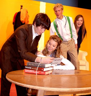 Leon Tolchinsky (Sayer Smith) tries to educate Sophia Zubritsky (Jordan White) as her parents (Zak Heald and Christina Lovell) look on during drama practice at Gravette High School on Monday.