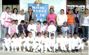 Carolina Morales, (back, left), stands with a class of the Lauro Aguirre Kinder in Celaya, Guanajuato, Mexico, where she taught kindergarten.