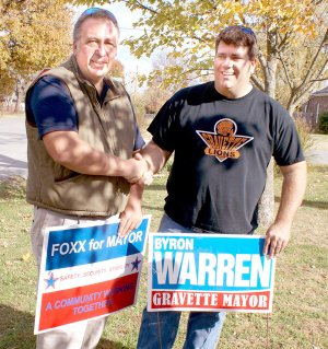 Ken Foxx and Byron Warren, candidates for Mayor of Gravette, shake hands as they worked together removing campaign signs after Foxx withdrew from the race. Both names will be on the ballot in a run-off election which is scheduled for Tuesday; however votes cast for Foxx will not be counted according to the Benton County Election Commission. Mike von Ree, who finished third in the initial balloting, filed suit in Circuit Court asking the election be voided, charging Foxx does not qualify for the office because of a question of his residence. Judge Xollie Clinger has been assigned the case and a ruling has not been made at press time.