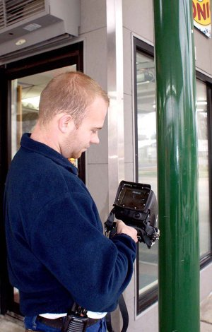 """Gravette fireman Spencer Gillming demonstrated the fire department's thermal imaging camara used to locate """"hot spots"""" when a blaze is not visible."""