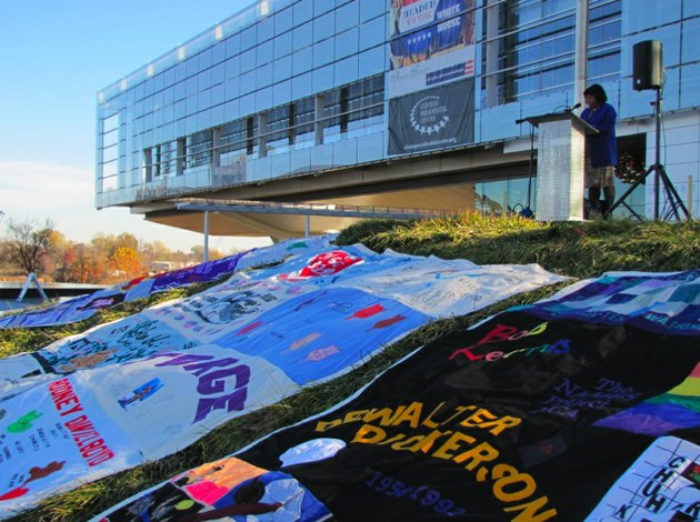file-volunteer-kimara-randolph-reads-the-names-of-people-who-died-from-aids-at-a-display-of-the-aids-memorial-quilt-wednesday-outside-the-clinton-center-on-dec-1-2010